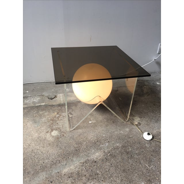 Super funky lucite base with thick smokey glass top. Ball light in the middle with foot press switch to turn the light on...