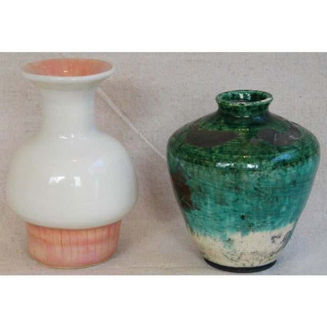 Set of two mid-century modern handmade studio art pottery vases displaying a wonderful glazed finish and shape. No maker's...