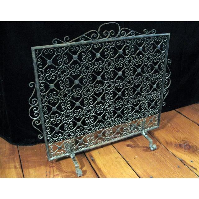 Vintage decorative wrought iron single panel fireplace screen.