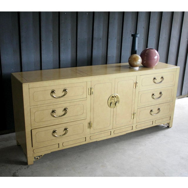Beautiful Chinoiserie dresser with faux parchment lacquered finish and heavyweight, high quality solid brass hardware....