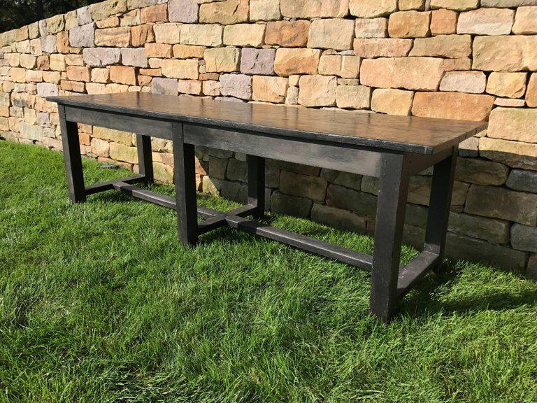 A Black Painted 19th Century Farm Or Work Table With A Distressed Black  Painted Finish.