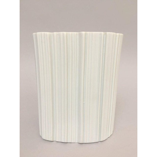 Modernist white bisque porcelain vase from Naaman Israel in an amorphous shape with ridged exterior, ca. 1980s. The vase...