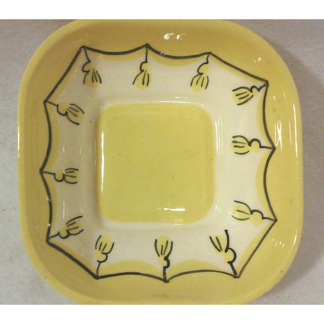 A vintage square ceramic dish in yellow with hand painted tassels under the glaze and a squared off shape. This is a...