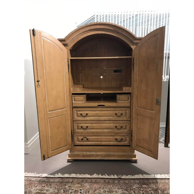 Beautifully stained wood entertainment cabinet. Features a large shelf on top, three large drawers, two smaller drawers,...