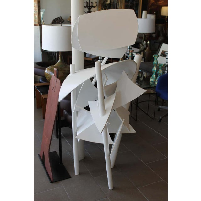 Steel Brutalist sculpture which we had sand blasted and powder coated a white satin. Artist initials and dated 1979. An...