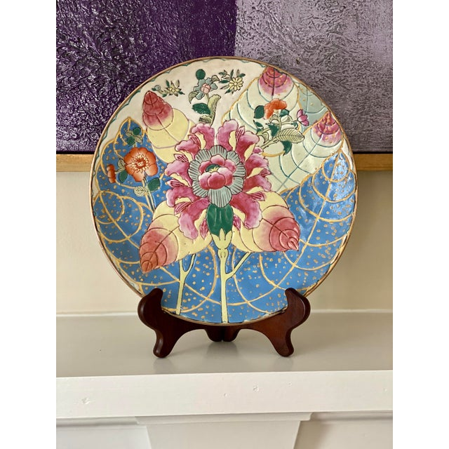 Beautiful tobacco leaf plate! It has texture and bold colors. It will look fabulous on your shelf or wall. The plate...