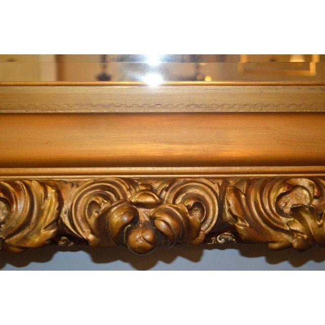 Stunning Rococo gilded and unusual hand-carved details on this 19th century frame from Italy. A new beveled mirror was...