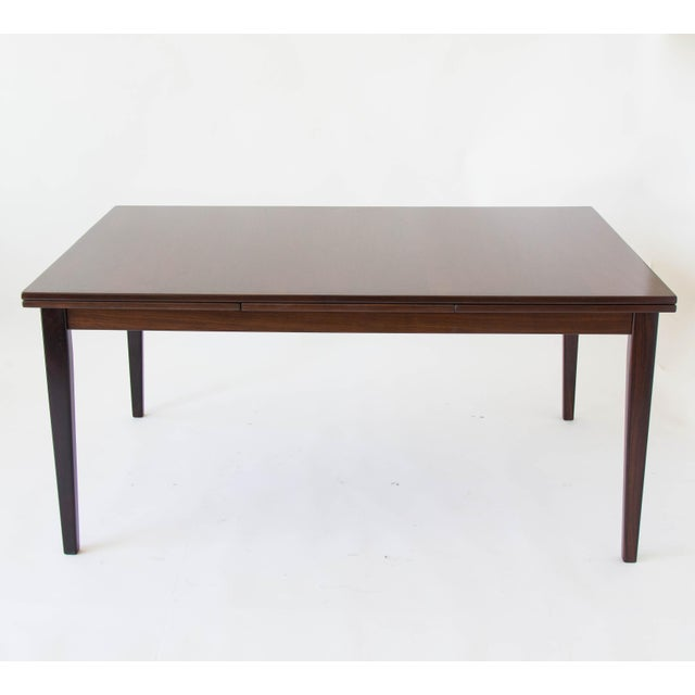"""Danish extending dining table in dark rosewood by Gudme Møbelfabrik. Simple design hides two 20.5"""" leaves the draw out..."""