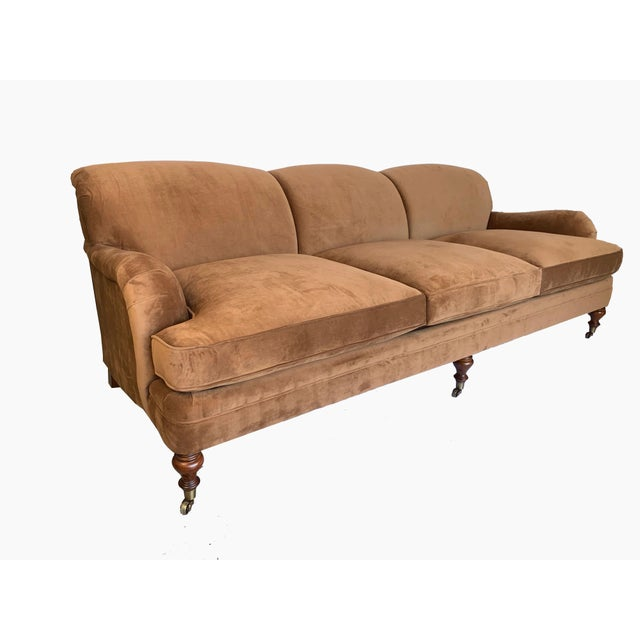Immaculate Ralph Lauren classic Langholm style sofa in a velvety brown faux suede. Brass wheeled mahogany front legs allow...