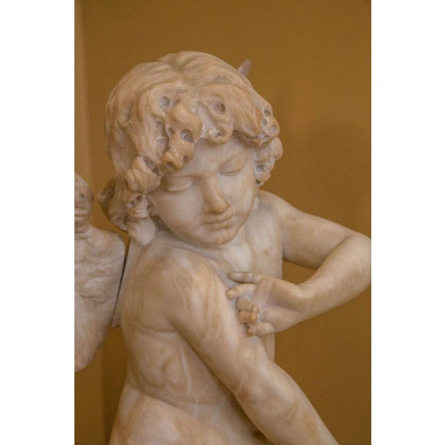 Stone Alabaster Figure Winged Angel Sitting on a Pillow on an Alabaster Pedestal For Sale - Image 7 of 9