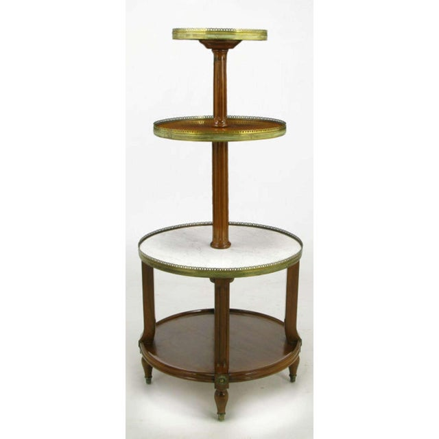 French walnut four tier server table with concentric circular tops of alternating Carrera marble and walnut. Top three...