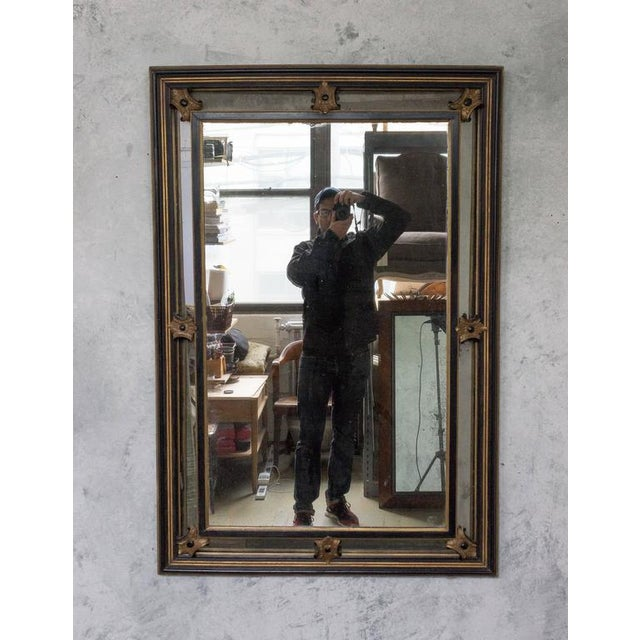 """French Napoleon III 19th century mirror with carved gold and black decorations. Measures: 53"""" x 35."""