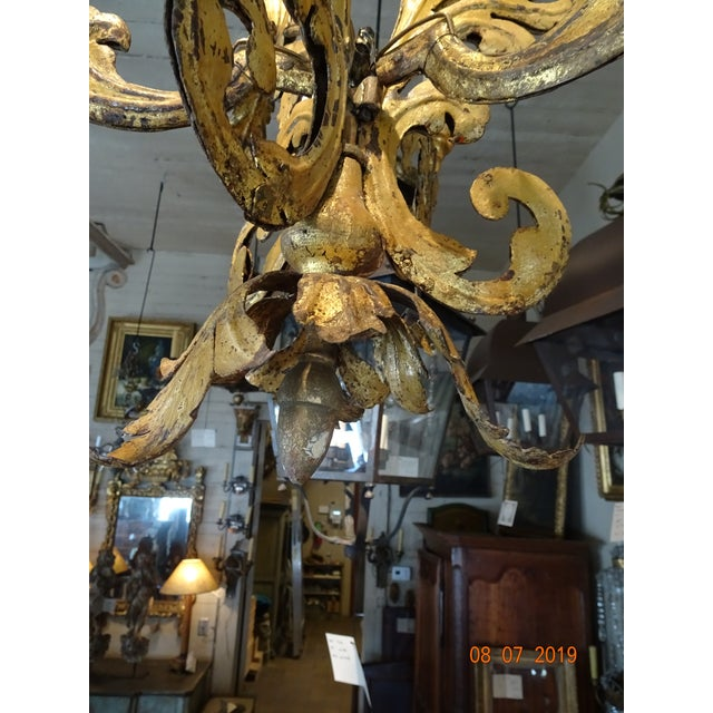 Precious Italian , from Venise , small gilt tole 3 lights chandelier. US wired. Intricate design of acanthus leaves....