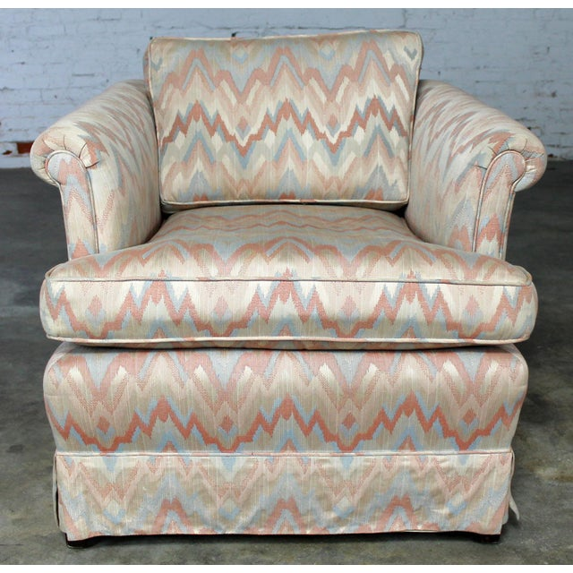 Great tuxedo style lounge chair with rolled arms and loose back and seat cushions. Circa 1980s. Upholstered in a classic...