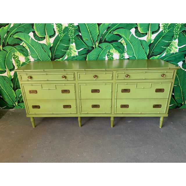Vintage dresser by Ficks Reed features faux bamboo/rattan detailing and brass hardware. No markings. Very good vintage...