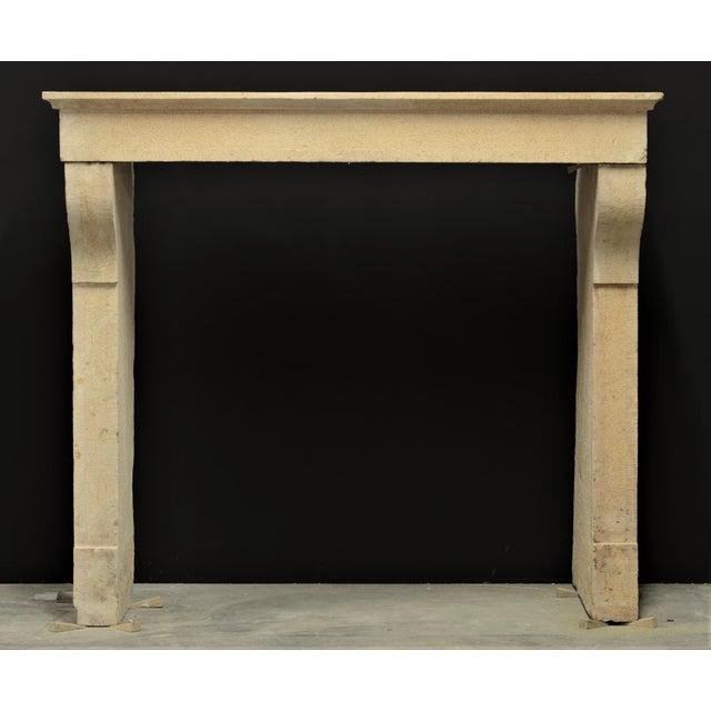 Solid, elegant Burgundy limestone French antique fireplace, 19th century.