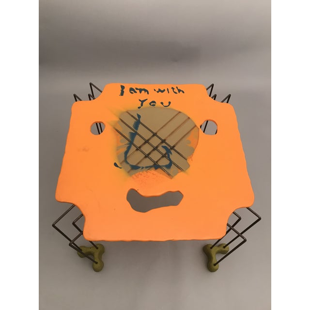 """A unique coffee table by Gaetano Pesce for Chiat / Day, 1994. Face design with inscription, """" I am with you."""" Resin and Steel"""