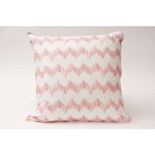 This pretty in pink throw pillow by Christen Maxwell is truly one-of-a-kind! It features a pink zig zag pattern that began...