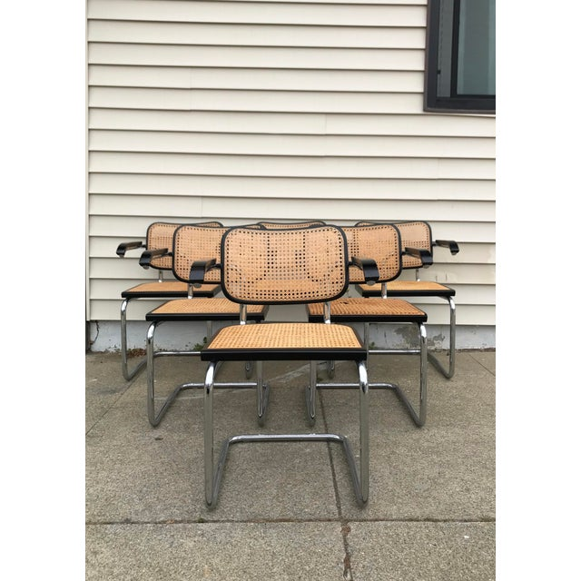 This is a set of 6 Marcel Breuer style mid-century modern tubular steel beech wood cane chairs. The pieces were made...