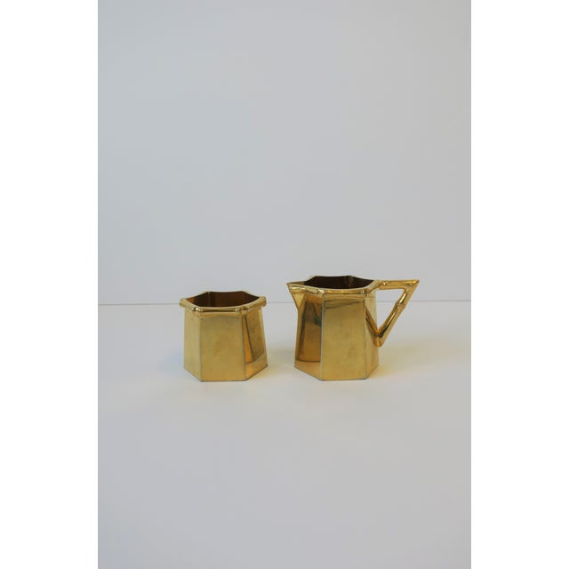 A chic vintage 1960s-1970s brass plated tea/coffee creamer and sugar set with bamboo detail in the Hollywood Regency...