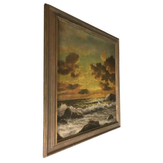 This is a nicely framed mid-20th century sunset coastline seascape oil on canvas.