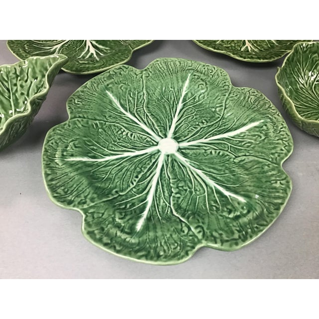 This is an assortment of 5 pieces of Bordallo Pinheiro cabbage design pottery. Consisting of 3 plates of various graduated...