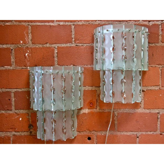 Pair of Italian beveled glass sconces by Cristal Art.