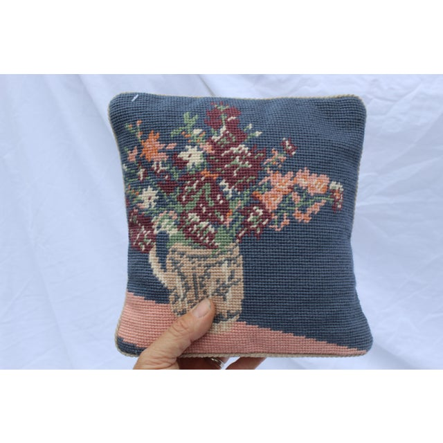 20th century wool needle point pillow in blue and pink with light grey piping, and beige velour back. Cottage style.