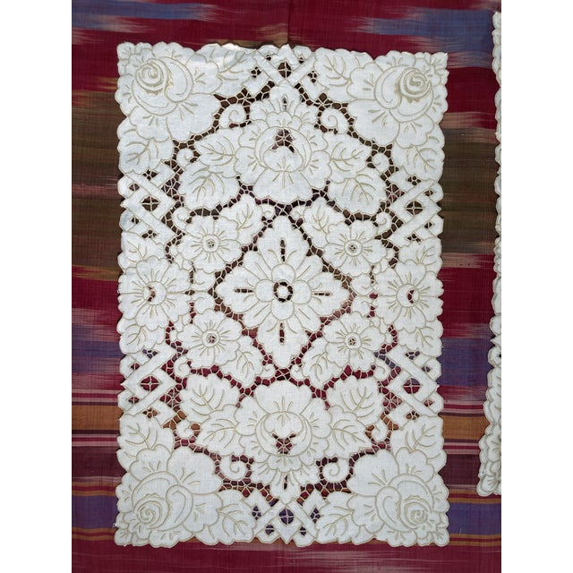 A set of linen heavily embroidered open work placemats, starched pressed and ready to serve!