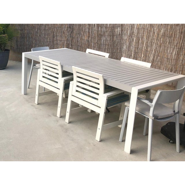 The modern outdoor dining table is minimalist and stylish. It features gray paint-coated, rust-proof, fully welded...