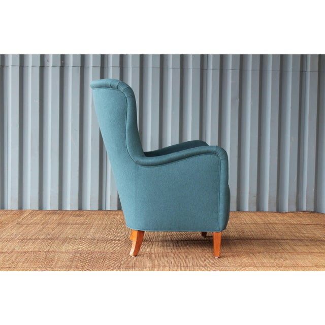 Early Modern armchair designed by Ernest Race, 1940s, England. Recently upholstered in a beautiful dark teal fabric. His...