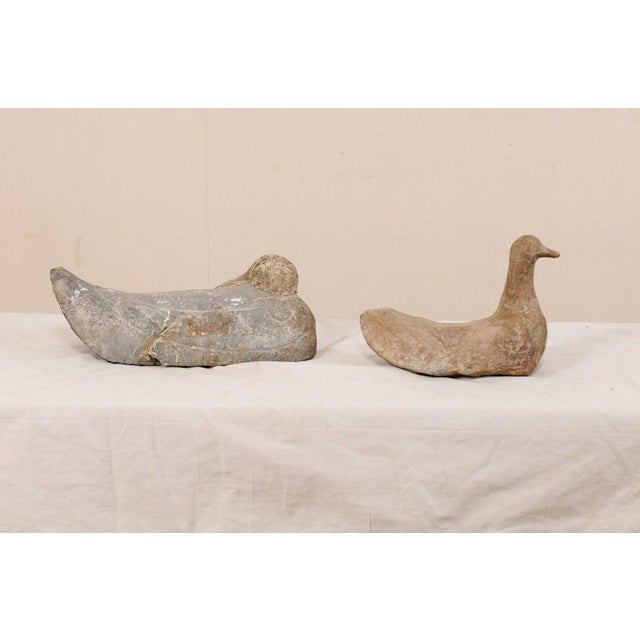 A pair of French carved stone ducks from the 19th century. This delightful pair of antique stone ducks from France have...