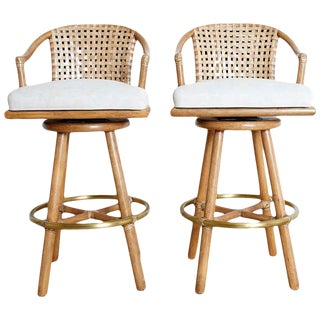 Pair of McGuire Woven Leather Rattan Swivel Barstools For Sale