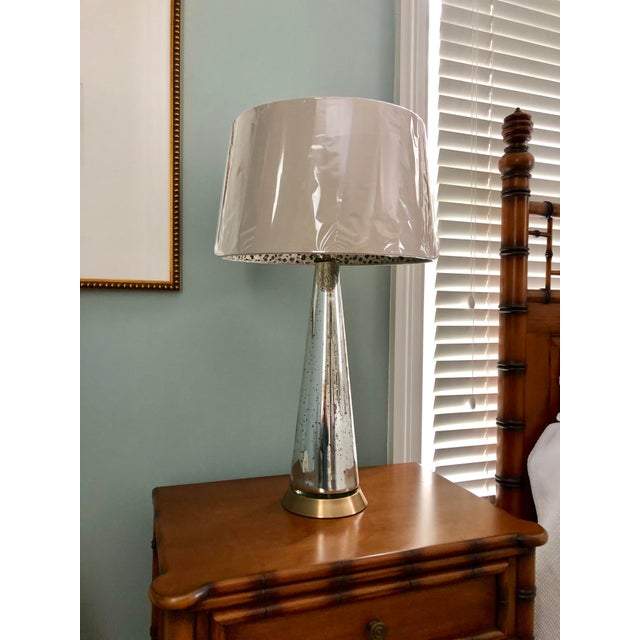 This pair of Arteriors lamps are in perfect condition, with the shades still wrapped. They have never been used and would...