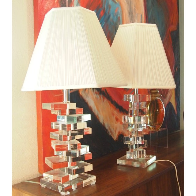 This is an awesome pair of Mid-Century, Bauer Clearlite, stacked Lucite lamps rendered in the Karl Springer style. One is...