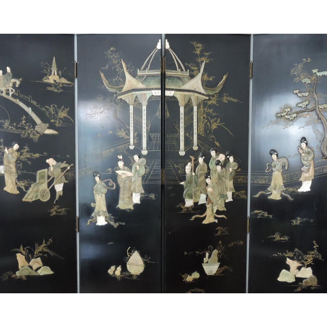 Ornate antique Chinese four panel screen featuring an idyllic ornamental garden scene with hand crafted high quality jade...