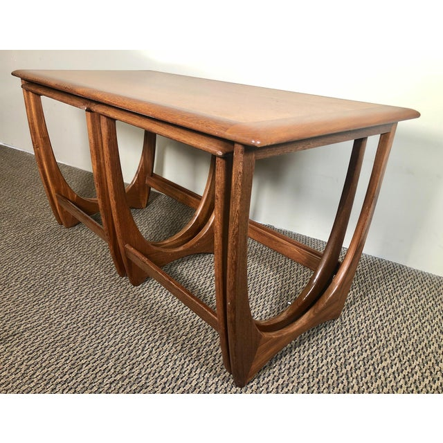 This is a gorgeous teak nesting coffee table with a beautiful leg design. Made by G Plan. Excellent condition. Minor signs...