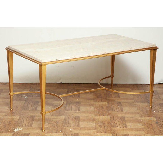 Rectangular gilt iron coffee table with travertine top, by Maison Ramsay, France, circa 1960. Available to see in our NYC...