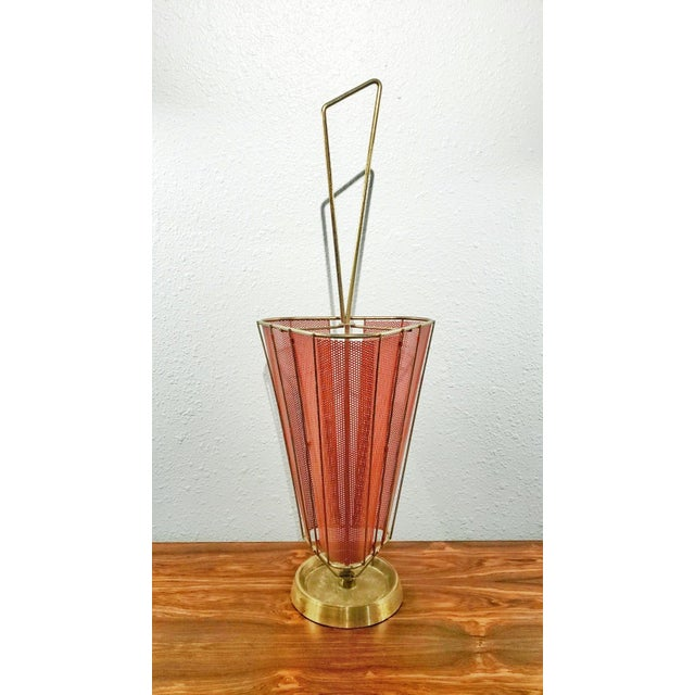 A red triangular perforated metal and brass umbrella stand in the manner of Stilnovo/Mathieu Mategot. Patina Intact....