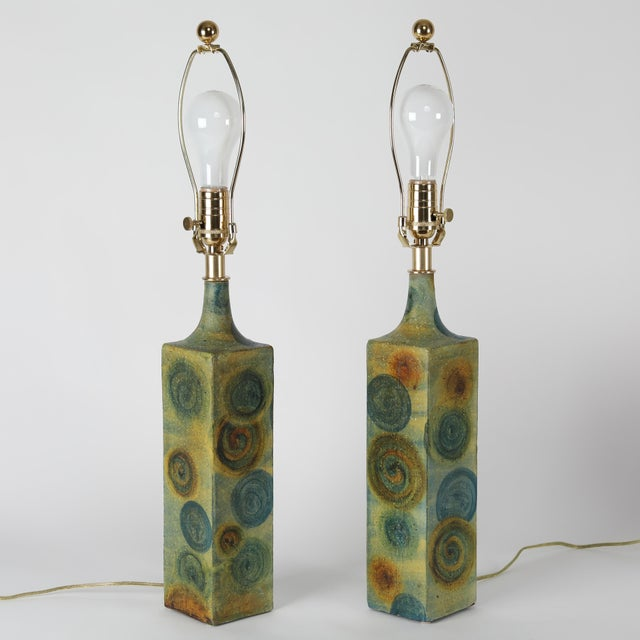 Fine pair of 1960's ceramic table lamps by noted Italian designer Marcello Fantoni. The square bases are hand-painted in...