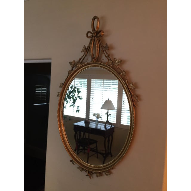 "Beautiful French gilt oval mirror. Measures 26"" x 47"". Beautiful for a powder room, master bedroom-endless options...."