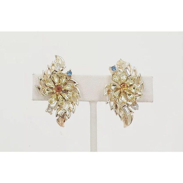 Goldtone teardrop faux-citrine with faux-topaz center flowers with round faux-sapphire and baguette and round clear...