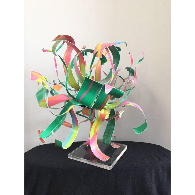 "Rare ""Starburst"" sculpture by American artist Dorothy Gillespie (1920-2012). Enameled aluminum ribbons in vivid colors on..."