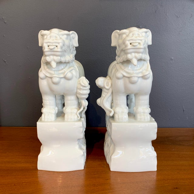 A pair of vintage blanc de chine foo dogs. Great as bookends or sculptural decor.