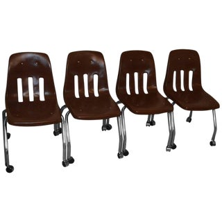 Desk Chairs Set of Four With Chrome Legs and Vinyl Shell on Wheels, Circa 1970 For Sale
