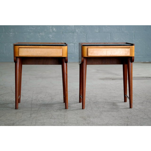 Elegant pair of small Danish 1950s nightstands made from teak and elm wood topped with black glass. Simple yet very...