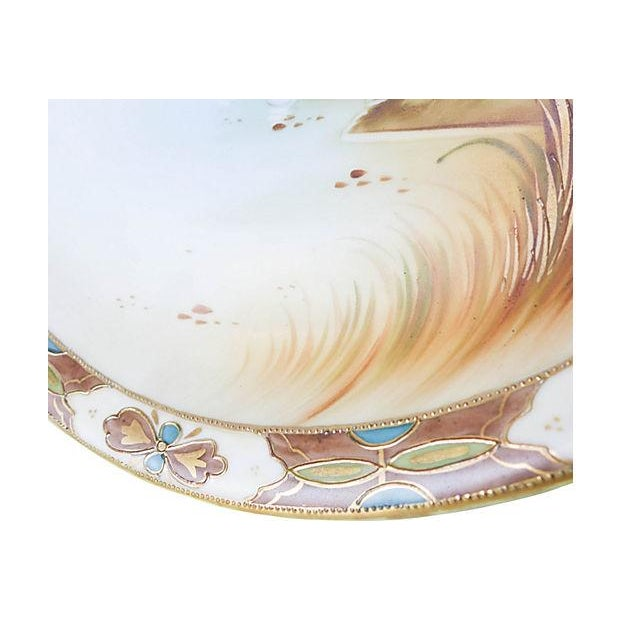 """Porcelain platter with hand-painted canal scene, circa 1910. Maker's mark reads: """"Nippon Hand Painted."""" Very good, some wear."""