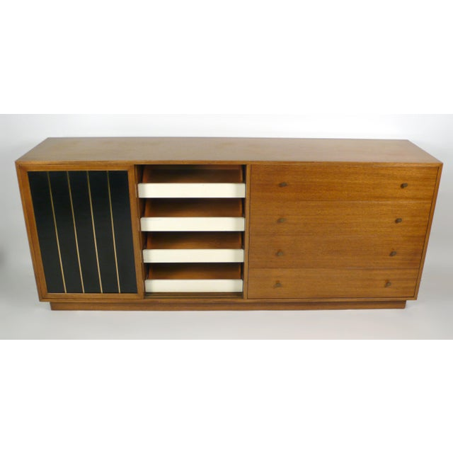 Mahogany and leather Probber Dresser with brass trim and hardware. Doors slide open on solid brass rails to reveal cork...