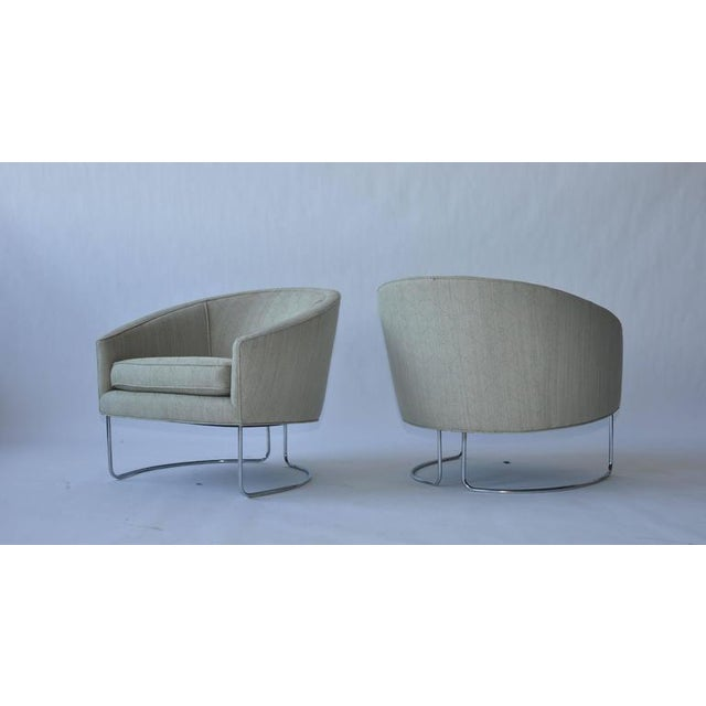 1960s chrome base curved lounge chairs.