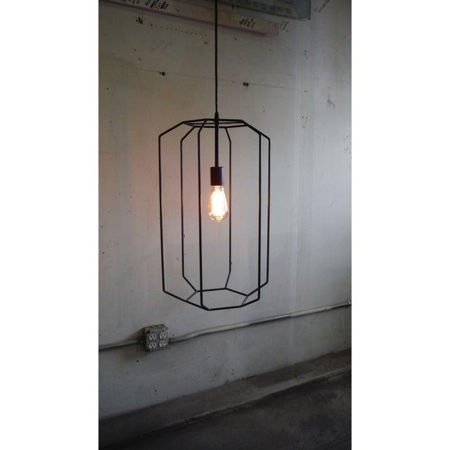 A lantern to catch St. Elmo's fire. Handmade vintage inspired light pendant. Hand rubbed gun blue patina.